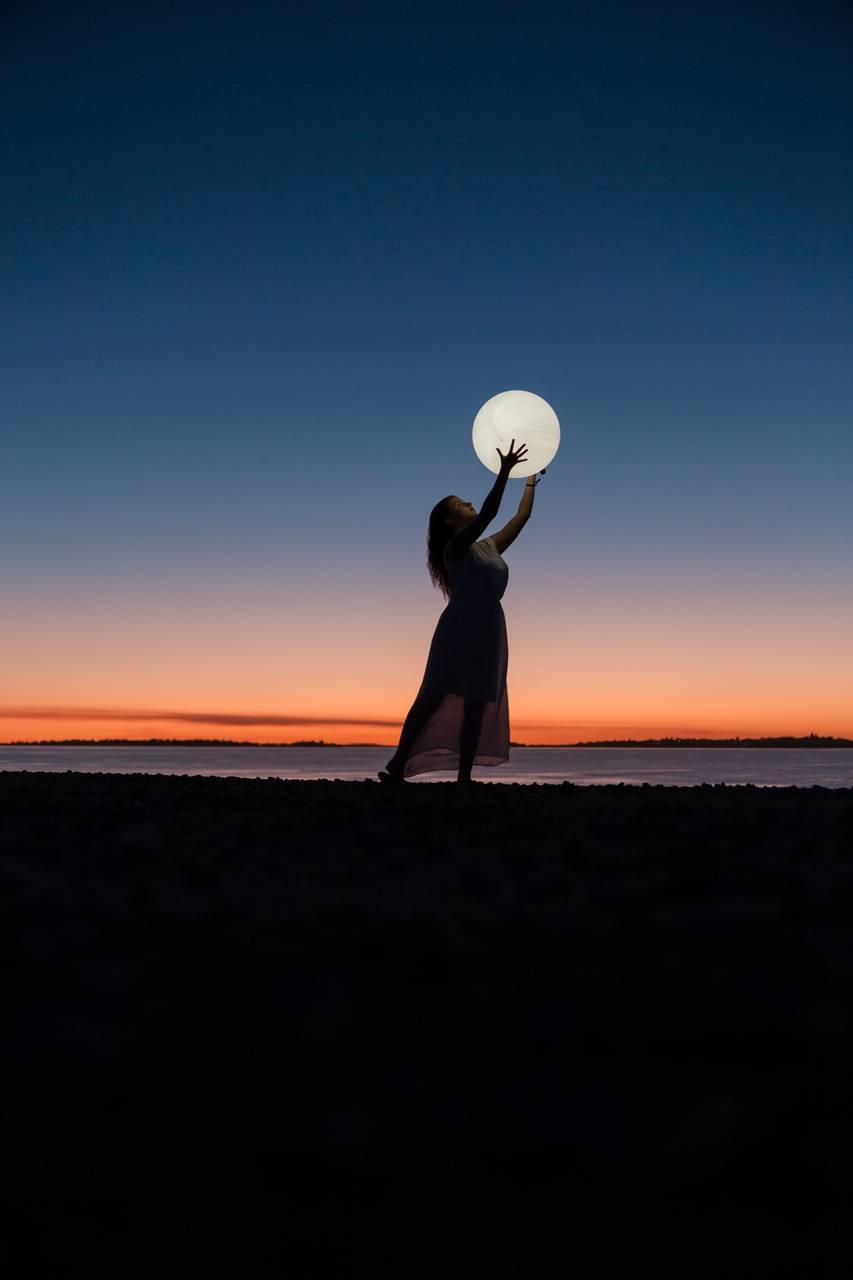 Women Holding Moon