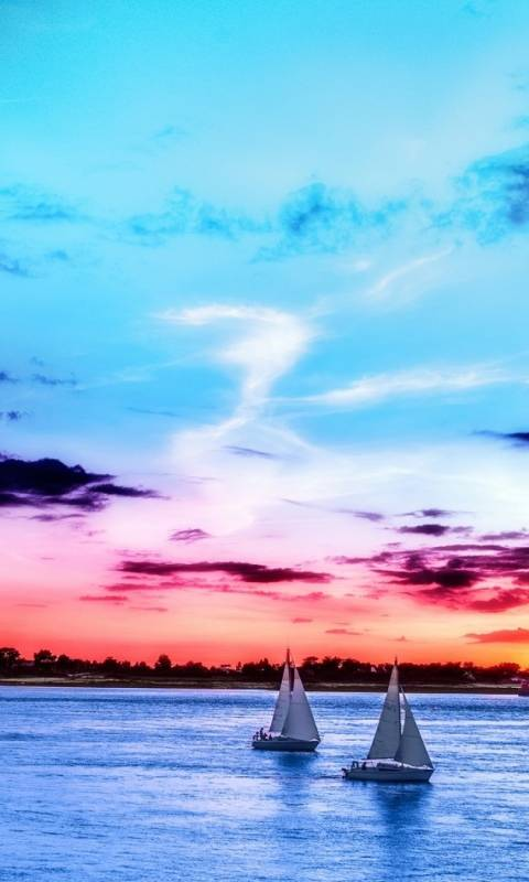 sunset sailboats