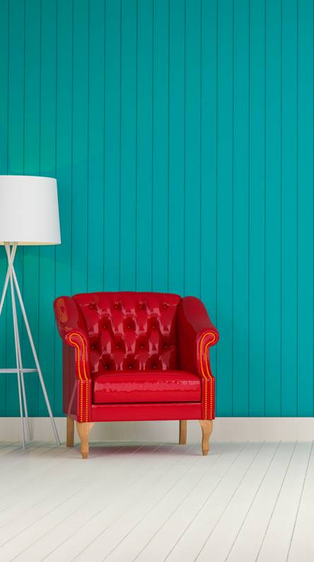 Blue wall red sofa