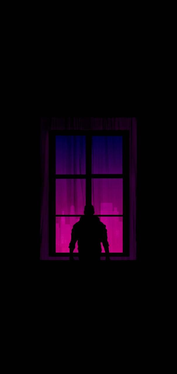 Boy behind window