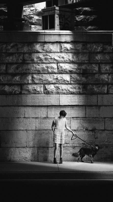 woman dog street