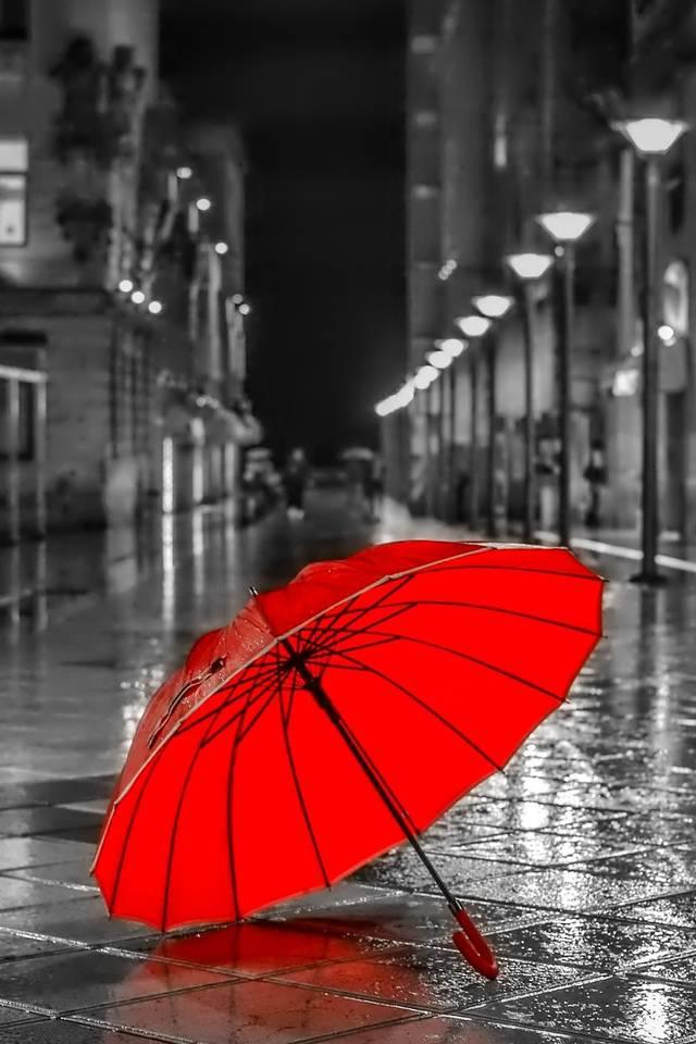 red umbrella in city