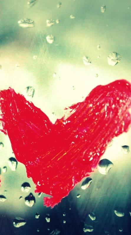 Heart rain on glass