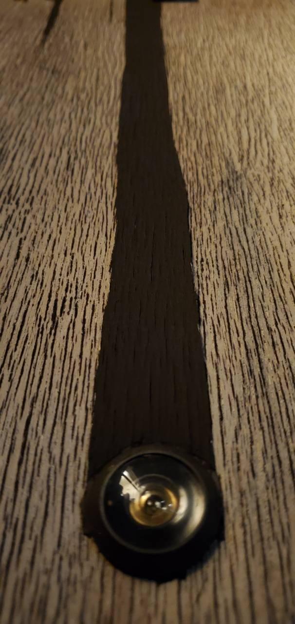Wooden peephole