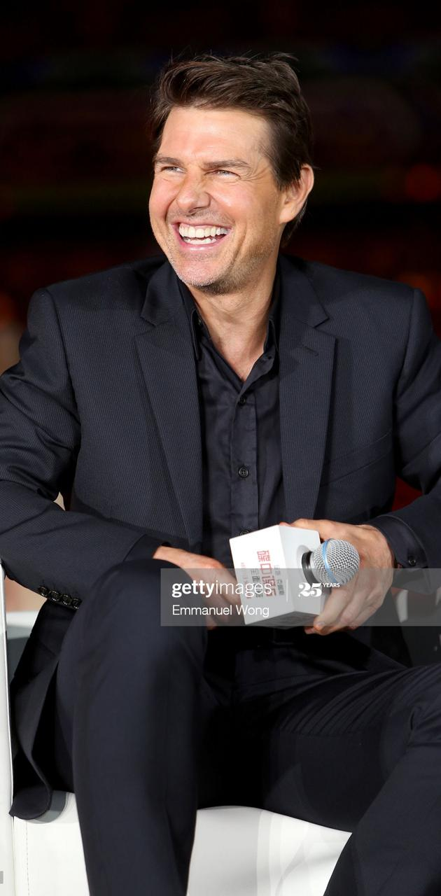 Tom smile