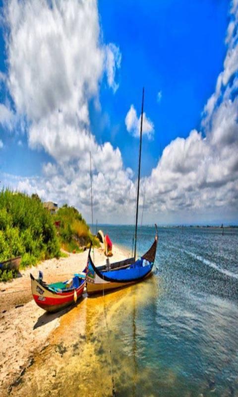 2 boat near ocean