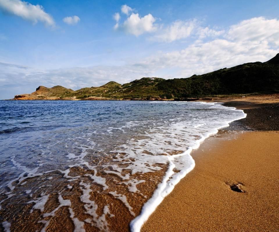 Waves On Sand Beach