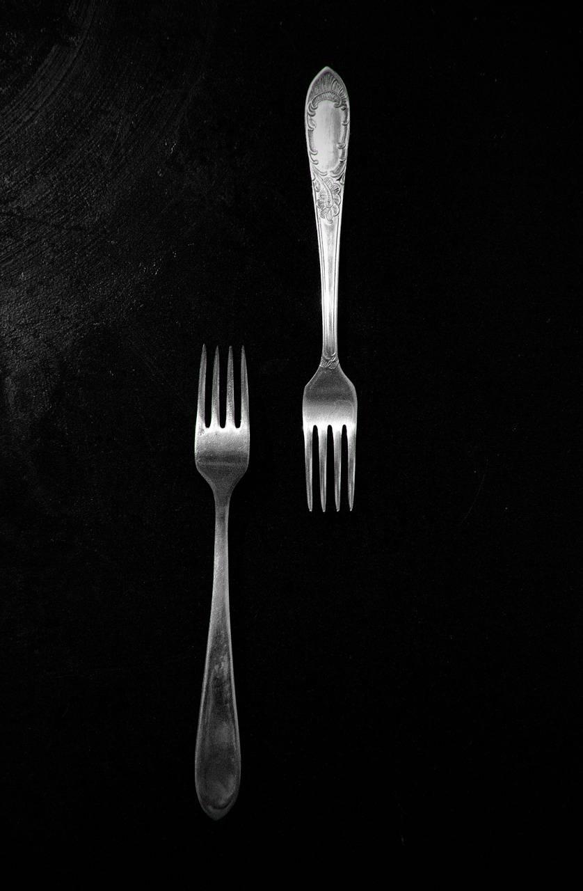forks a black table